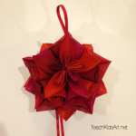 Origami Flower Balls - Step 5. Assemble flowers into a ball by gluing the curved edges together, matching the points at the top of each flower. (Insert and glue ribbon for hanging when you have half of the flowers glued together.)