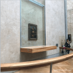 Mona is well-protected with her bullet-proof glass case and personal security guards