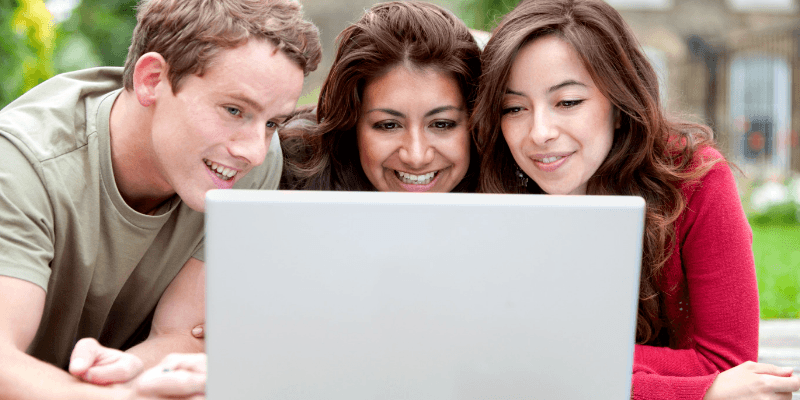 group looking at laptop