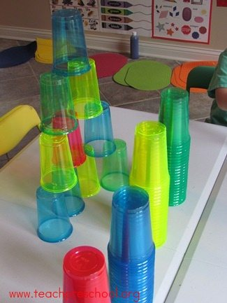 Exploring colorful cups in preschool