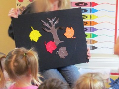 Painting fall trees with egg cartons in preschool