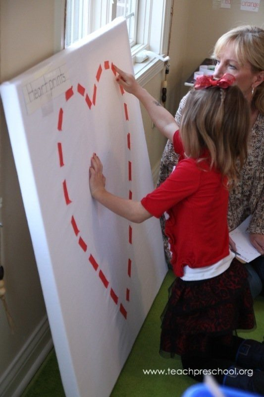 Tracing letters, numbers, and shapes on the flannel board