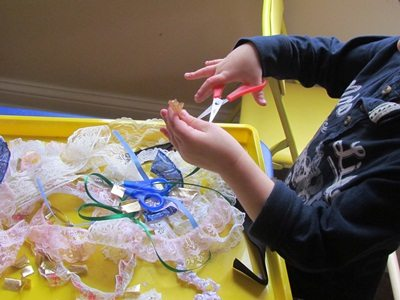 Ribbon and lace sensory play in preschool
