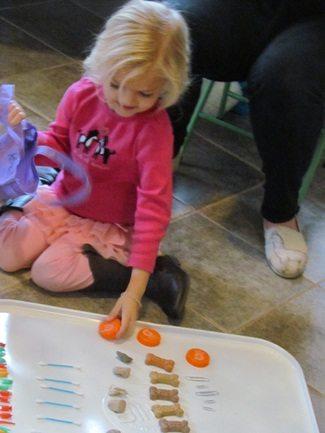 Building basic math skills in preschool: Sorting our math tokens