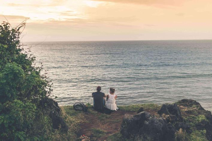 couples-meditating-by-the-ocean