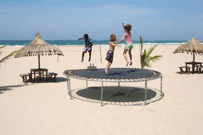 children-jumping-on-trampoline