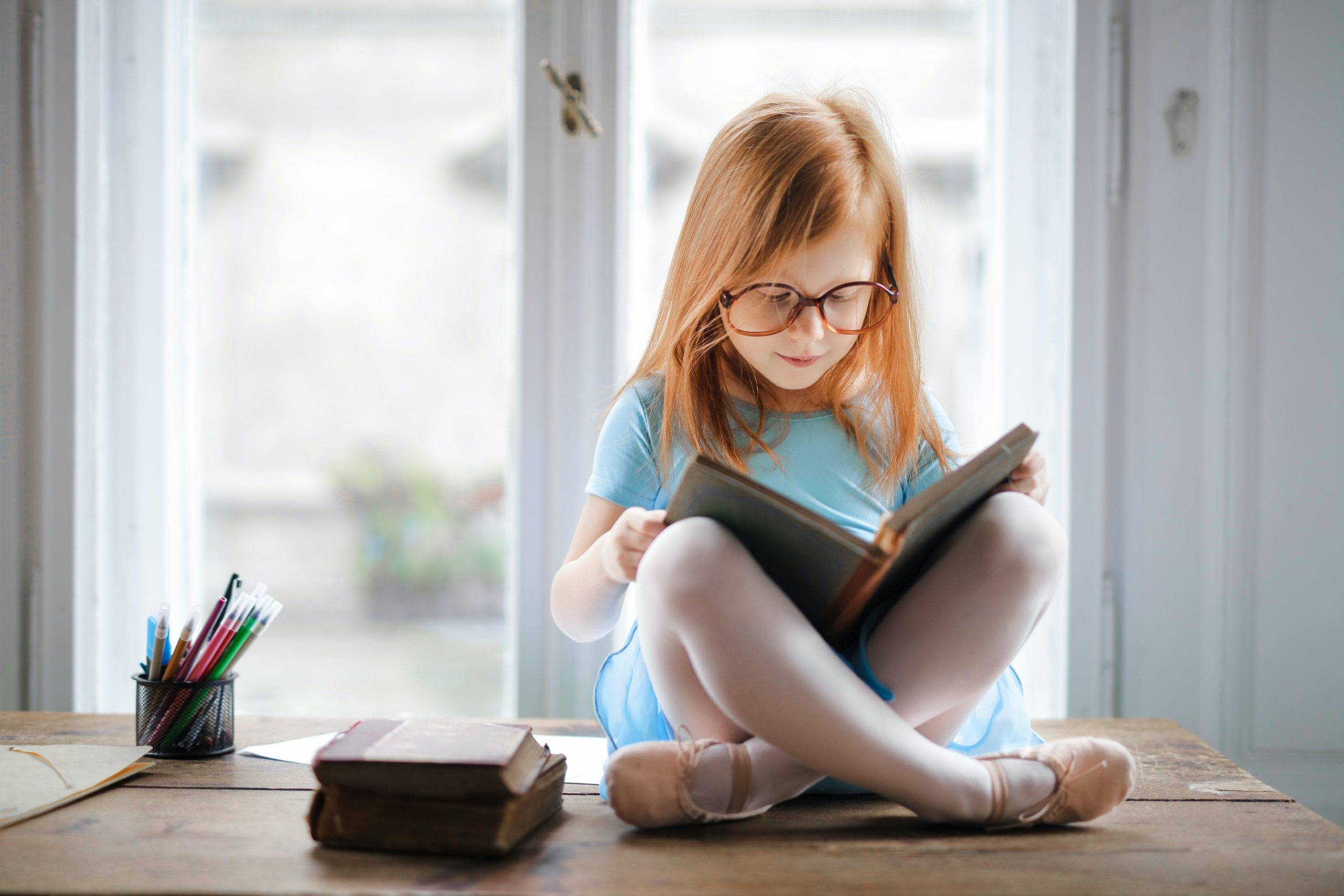 child reading to learn about language