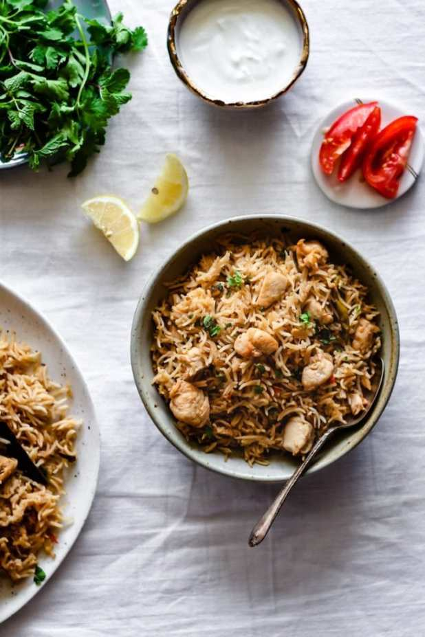 Instant Pot Chicken Pulao in a bowl garnished with cilantro.