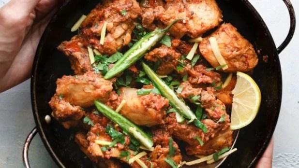 Holding Chicken Karahi in a karahi