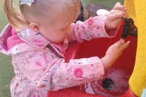 Washing hands in or out of doors with a Teal KiddiSynk at Honey Pot