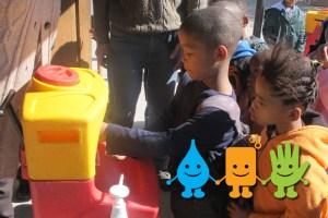 Children washing hands as part of Global Handwashing Day