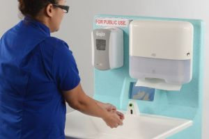 Hands being washed with a MediWash portable unit