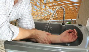 Washing hands with a portable sink on a building site