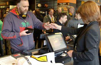 Fan handing over TeamCard