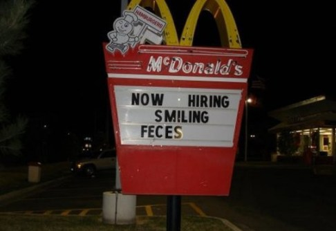 Now hiring smiling feces Mcdonald's sign funny names misspelled signs, now hiring, bad fart, funny store signs, fun advertisements, ads, worst ever, bad, street signs, real estate, misspelled, wrong, fail, stupid, wtf, bad product names, funny names, funny people, wrong place wrong time,