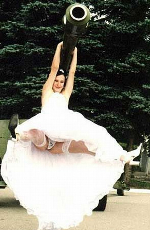 Tacky Bride Spreads her legs, Funny Wedding Photos, wedding photography, worst wedding pictures, wedding disasters, wedding announcements, engagement announcements, awful wedding pictures, horrible, stupidity, ugly wedding dresses bridesmaid dresses