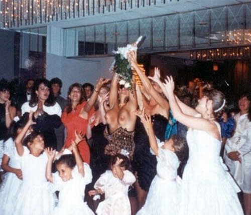 Tossing the Bouquet, Boobs fall out of dress, Funny Wedding Photos, wedding photography, worst wedding pictures, wedding disasters, wedding announcements, engagement announcements, awful wedding pictures, horrible, stupidity, ugly wedding dresses bridesmaid dresses