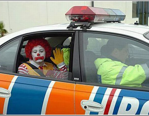 Ronald McDonald gets arrested in police car funny pictures stupid people weird pictures random bad family photos awkward family photos product names