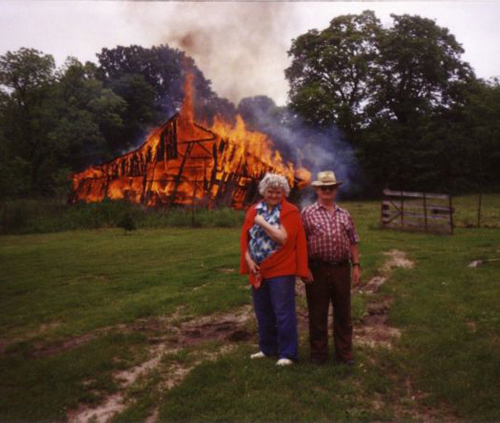 old couple in front of burning barn Family Portraits Bad Family Photos Ellen worst family pics funny pictures awkward family photos wtf ugly people stupid people crazy people weird people