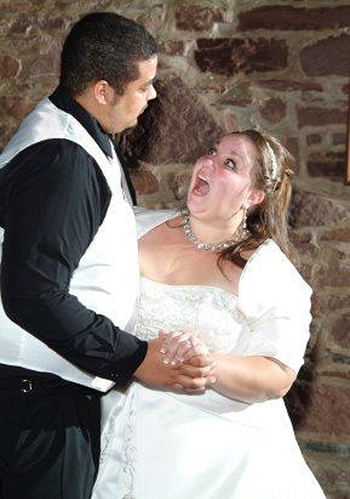 funny face on bride bridal dance first dance wedding dance groom zipping pants Funny Wedding Pictures Bad Wedding photos worst wedding pic ugly wedding dresses drunk bride groomsmen awkward family photos bad family bridesmaid dresses wedding receptions wedding djs russian wedding worst tattoos bad tattoos