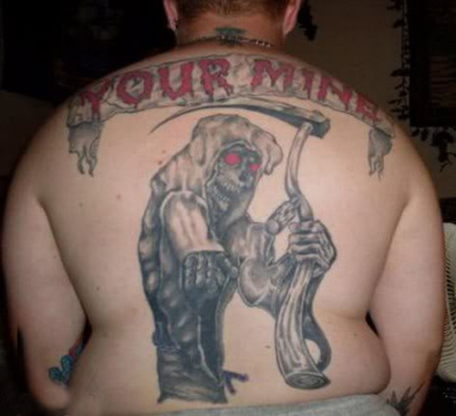 Your Mine Misspelled tattoos You're Mine regrettable bad tattoos terrible awful ugliest tattoos wtf ugly horrible tattoos funny tattoos awkward family america's worst tattoos photos crazy people weird stupid redneck humor