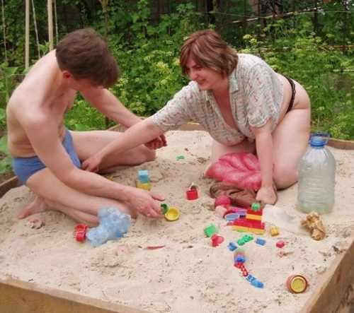 Couple in underwear in sandbox Bad Family Portraits, Bad Family Photos, Ellen, funny family photos, worst family pics, funny pictures, awkward family photos, wtf, ugly people, stupid people, crazy people, people of walmart