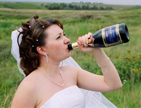 Bride chugging champagne from bottle ~ 14 Funny Wedding Pics