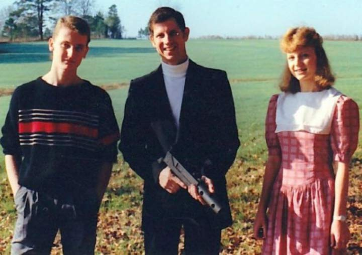 Dad son daughter in field with gun ~ 18 Funny Awkward Family Photos
