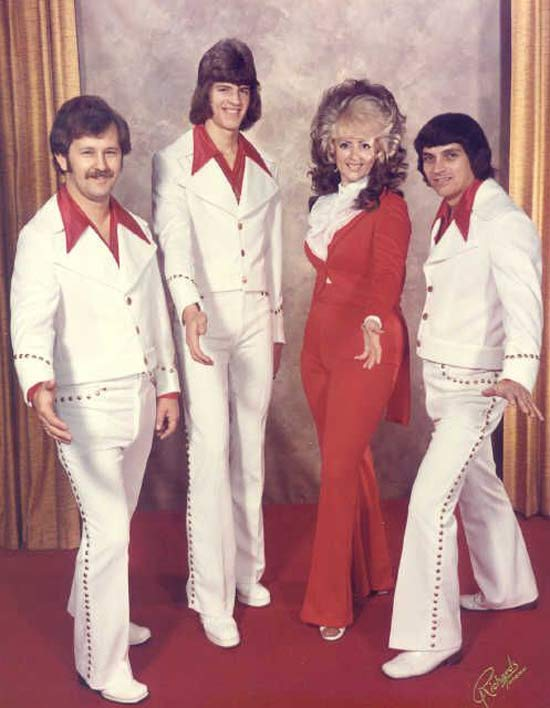 Vintage Snap: 1970s Promo Pic of Singing Group, White Suits, Big Hair