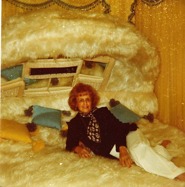 Vintage snapshot grandma on fuzzy bed 1970s sexy