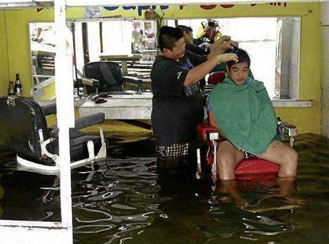 Man getting haircut in flooded barbershop