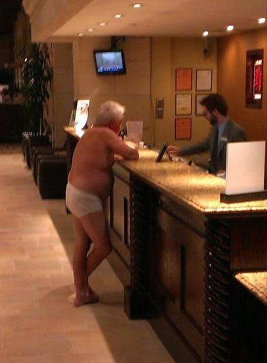 Old man in whitey tights underwear in hotel lobby