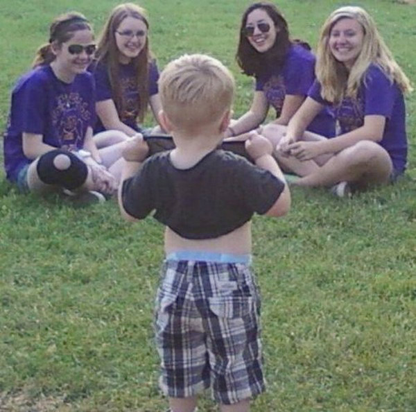 Toddler boy flashing his boobs to a bunch of girls
