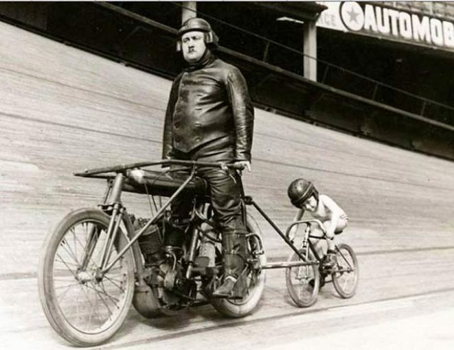 Vintage photo: velodrome with fat man on bicycle with boy