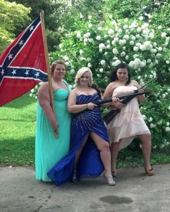 Awkward snapshot of girls on prom night with confederate flag and guns