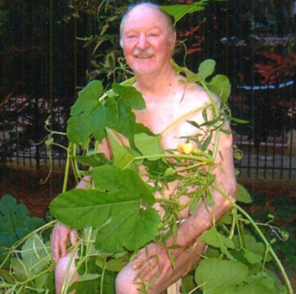 Awkward snapshot of naked grandpa covered in pumpkin vines & leafs