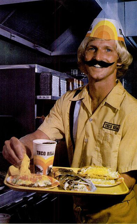 Vintage snap 1970s Guy working at Taco Bell with fake Mexican mustache
