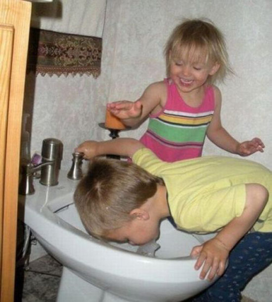vintage color snap kids, brother and sister striking from bidet ~ Awkwardly Funny Family Photos