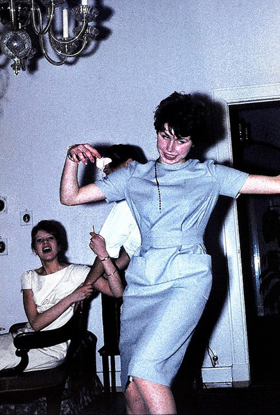 Vintage color snapshot 1960s of drunk woman dancing at home