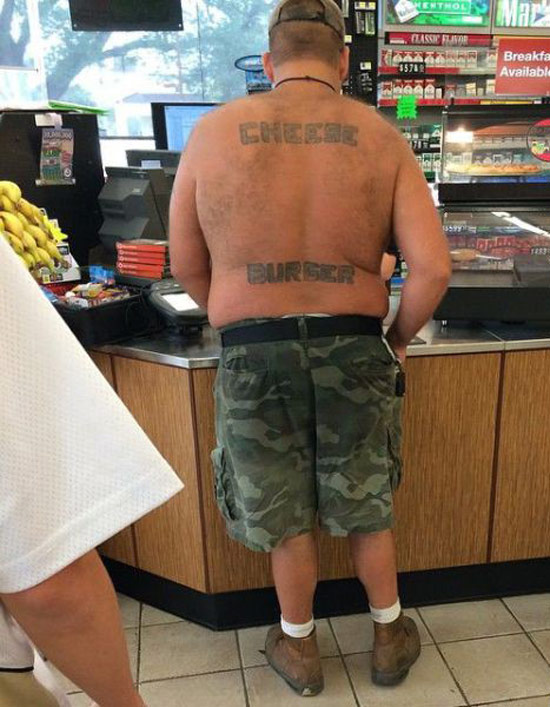 Shirtless man in a convenience store with Chees Burger Tattooed on back ~ The ugliest worst bad tattoos