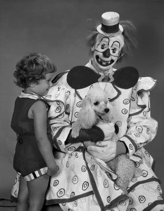 Creepy Old Vintage Photos~ scary clown holding poodle