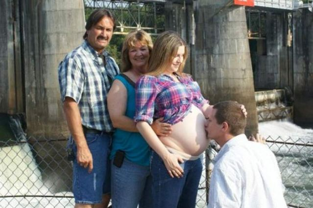 Funny Bad Pregnancy Photos ~ Husband on knees kissing wife's belly as she's hugged from behind by her mom & dad, rednecks