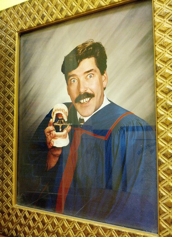 Funny graduation pic from dental school, guy in robe holding dentures ~ Awkwardly Funny Family Photos