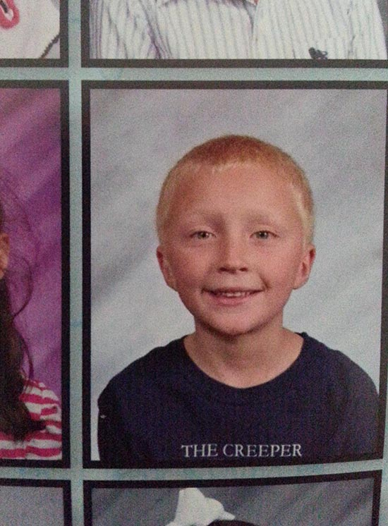 "Funny school picture of boy with T-shirt that says ""The Creeper"""