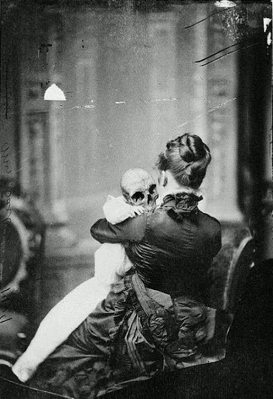 Scary Weird Creepy Old Photos ~ woman with skeleton baby