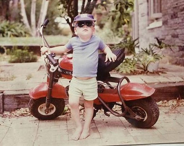 cool baby with swag leaning agains motor bike ~Funny Awkward Family Photos