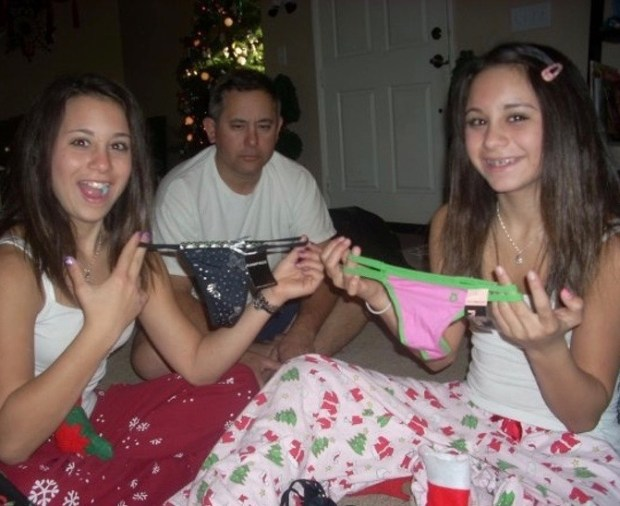 26 Funny Family Christmas Photos ~ distraught dad with daughters who got thongs for Christmas
