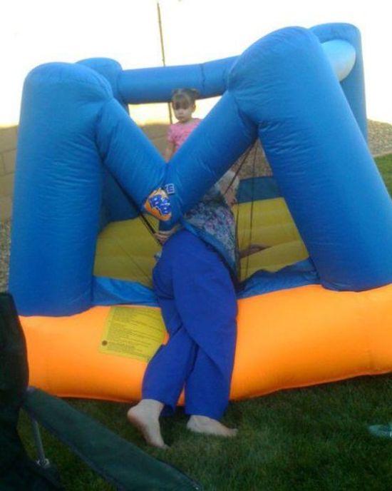 Funny Awkward Family Photos: grandma stuck in blow up bounce
