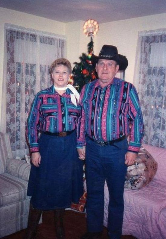 funny awkward Christmas pics, vintage color snap, mon & dad in matching cowboy outfit posing in front of Christmas tree, early 1960s