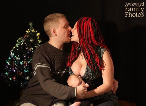 Funny Awkward Christmas Photos ~ Holiday card, couple kissing big boobs squashing baby